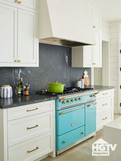 Why not pair a retro kitchen range with a cool, black marble backsplash? The white range hood pulls it all together. Take a tour on HGTV.com.