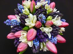 A lovely bouquet of bulb flowers; tulips, narcissus, hyacinths and grape hyacinths - by Stacey Halstead of @florissimo.