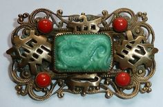 Max Neiger small Oriental style brooch.  (The 4 glass stones should be a bit more orange!)  Photograph Gillian Horsup.