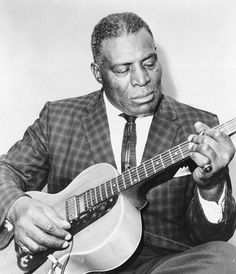 Howlin' Wolf. Brassy blues singer, guitar and harmonica player. 1910-1976.