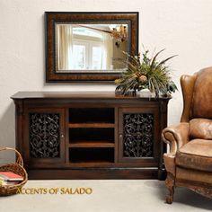 Tuscan Decor typically will incorporate hard wood furniture Dark