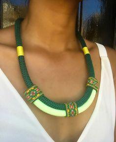 www.cewax.fr love this statement necklace ethno tendance, style ethnique, #Africanfashion, #ethnicjewelry - CéWax aussi fait des bijoux : http://www.alittlemarket.com/collier/fr_collier_plastron_multi_rang_ethnique_en_tissu_africain_beige_prune_jaune_-15921837.html - Ce collier est classe, féminin et élégant. Il peut se porter en toute occasion. - Pièce unique - Fait main - Léger à porter - Matériaux :