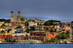 THE WORLD GEOGRAPHY: 11 of the Most Colorful Cities in the World: St. John's is the capital and the largest city of Newfoundland and Labrador, Canada. Oh The Places You'll Go, Great Places, Beautiful Places, Places To Visit, Amazing Places, Beautiful People, Newfoundland Canada, Newfoundland And Labrador, Disney Magic