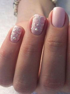 Pairing a pastel wedding nail color with white nail art is a bold manicure choice to show off your bridal bling.