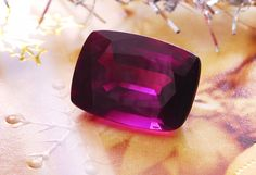 Dark red-purple Umba sapphire cushion weighing 4.87 cts, from Umba Valley, Tanzania. Umba sapphire is a unique type of sapphire discovered at 1962 in the Gerevi Hills, north of the Umba River in the Umba Valley of Tanzania.