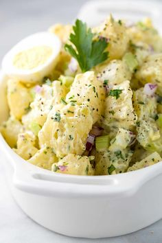 All-American potato salad in a white bowl ready to serve at a bbq or picnic