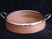I bought this gorgeous hand woven pine needle and nickel serving basket today--at a steep discount, natch.