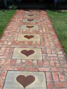 Stepping Stones and Path Combo to Update Your Landscape Create a brick walkway and then accent it with concrete stepping stones printed with heart shapes.Create a brick walkway and then accent it with concrete stepping stones printed with heart shapes. Brick Walkway, Brick Path, Brick Sidewalk, Concrete Walkway, Pathway Stone, Sidewalk Ideas, Gravel Walkway, Brick Paving, Concrete Stepping Stones