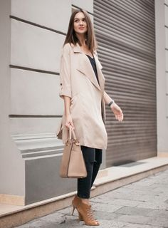 nude coat with all black outfit and suede lace up sandals