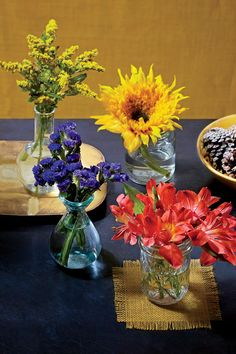 This two-minute tableau is as simple as separating stems into individual vases or jars. Stick to three or four colors in this grouping, but don't waste the rest—a single petite vase can stand alone on a windowsill or nightstand.     MATERIALS: bouquet of mixed fall flowers (goldenrod, sunflower, statice, alstroemeria)   VASES: small glass vessels