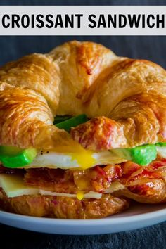 Recipes Breakfast Sandwiches This warm croissant breakfast sandwich loaded with crispy bacon, white cheddar, avocado, and eggs. It is the ultimate breakfast sandwich recipe. Croissant Breakfast Sandwich, Breakfast Sandwich Recipes, Breakfast Bake, Breakfast Ideas, Gourmet Recipes, Cooking Recipes, Healthy Recipes, Brunch Recipes, Homemade Croissants