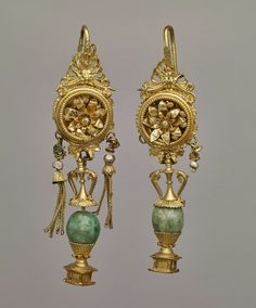 Hellenistic Greek gold,emerald, plasma and pearl earrings,with pendants in the shape of amphoras,dated to the 2nd century B.C.
