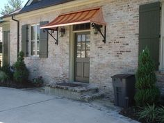 What a fantastic design for limited space! This side entry has limited space due to the driveway. By incorporating a double-sided step and adding an extremely attractive copper awning, there is no doubt where these home owners want you to enter! image from city-data.com