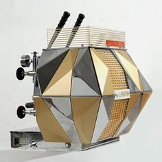 the multi-faceted looks of La Pavoni 'Concorso' coffee machine from 1956, designed by Bruno Munari and Enzo Mari.    Via twowheels+.