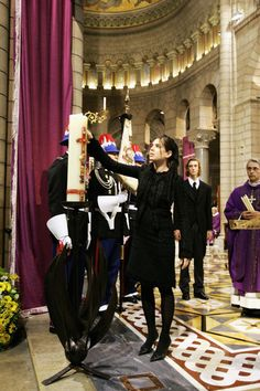 Charlotte Casiraghi - Funeral Of Monaco's Prince Rainier III.  Charlotte lights a candle at her grandfather's funeral mass, Monaco Cathedral April 15th 2005. Photo credit: Pool/Getty Images Entertainment.