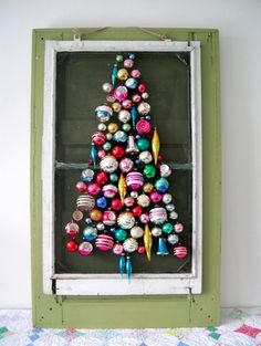 interesting creative ornaments arrangement forming a christmas tree