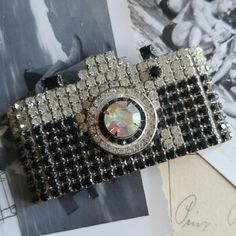 Vintage camera brooch by Dorothy Bauer Beautiful and collectible vintage brooch Made of sparkly rhinestones set in silver tone metal Handmade by California artist Dorothy Bauer Signed BAUER on the back In very nice condition with light surface wear From a smoke free home  Mausj8388camerai88 Vintage Jewelry Brooches