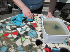 Clean the tiles with a damp cloth