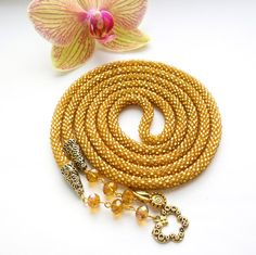 Hey, I found this really awesome Etsy listing at https://www.etsy.com/listing/262527847/golden-lariat-beaded-lariat-seed-bead