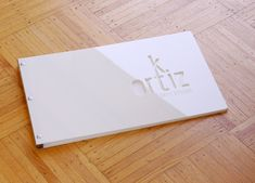 White acrylic screwpost portfolio with cut-out treatment and engraving treatmet