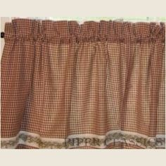 """Our Berry Vine Tier Curtain will add a very simple design to your country bath, laundry or kitchen.  Cloth is a woven dark red and tan mini-check with a berry vine trim applied.  100% Cotton, Cold Water Wash, Gentle, Tumble Dry.  Two tier panels in package. Total width 72"""" x 24"""" Long."""