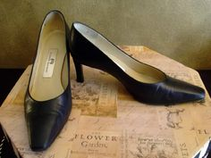 BBRANDNAME: ETIENNE AIGNER #162  MATERIAL: Leather  COLOR: Black  CONDITION: New!  SIZE: 8 1/2M  AVAILABLE  $39.99