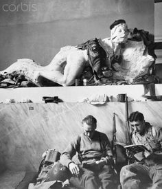 Original caption: Athens, Greece: Acropolis Bivouac. British paratroopers relax in off-duty hours in their billet in the historic Acropolis Museum in Athens. Most of the Museum's treasures were removed for safekeeping during the German occupation. The Tommies use some of those that remain for coat racks.
