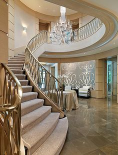 Built by Richard C. Architecture by Yarosh Associates, Inc; Interior Design by The Patterson Group; Photography by Richard Mandelkorn Staircase Railing Design, Luxury Staircase, Home Stairs Design, Interior Staircase, Dream Home Design, Modern House Design, Staircase Diy, Grand Staircase, Spiral Staircase