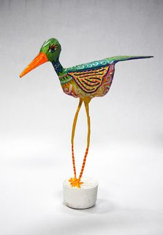 Papier Mache bird using wire legs and easy decoupage and masking taped newspaper body