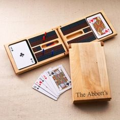 Personalized Groomsmen Gifts - NEW ITEM!  A wooden cribbage game set complete with two decks of cards, six pegs and held in a folding birch wood cribbage board. Personalize with 1 line of text, up to 20 characters. Use Coupon Code: Pin10 for a 10% merchandise discount.