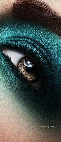 Teal gradient eye shadow.
