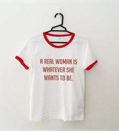 A real woman is whatever she wants to be ringer T-Shirt • Sweatshirt • Clothes Casual Outift for • teens • movies • girls • women • summer • fall • spring • winter • outfit ideas • feminism • feminist • hipster • dates • school • parties • Tumblr Teen Fashion Graphic Tee Shirt