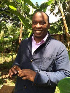 Ivan Mbowa from Umati Capital visits a macadamia nut farm