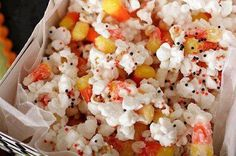 CANDYCORN POPCORN! Put two bags of popped popcorn and a bag of candy corn in a bowl, drizzle 1 package (16 ounces) of melted white almond bark over the popcorn and candy corn, then spread out on to wax paper. Sprinkle with halloween sprinkles and let cool 15-30 minutes. Then break it up and enjoy!!