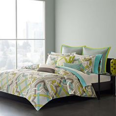 The Echo Status duvet cover set has a colorful contemporary design that instantly transforms your bedroom. The abstract geometric design features bold aqua, green, dark grey, and white lines intertwining on the face of the duvet cover creating a captivating design. Made from 100% cotton sateen, this duvet cover is machine washable for easy care. The set includes two king shams.