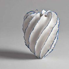 """Sandra Davolio, Born 1951 in Correggio, Italy creates porcelain tabletop objects that challenge our definition of a """"vessel"""". A hand thrown porcelain core is surrounded with paper thin """"fins"""" here edged with blue.... She does really unusual and curious sculptures...."""