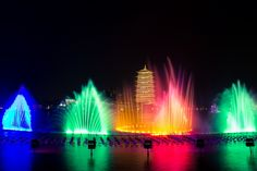 Pagoda and the audiovisual show in the square with the dancing fountain, China #travel #China