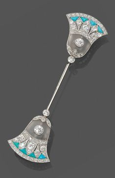 A rare Art Deco Egyptian Revival white gold, diamond and turquoise brooch, French.