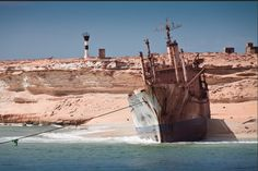 "lost ship-The M/V ""UNITED MALIKA"", a 387.8 foot reefer vessel with a cargo of fish ran aground in a remote location near the shore of Nouadhibou in Mauritania on August 4th 2003."