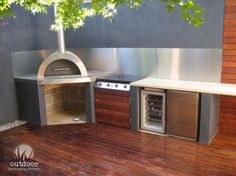 Grey rendered wall in outdoor kitchen