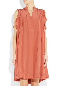 Peach silk crepe de chine Stand collar, slit at neckline, gathered shoulders, ruffled arm holes, side pockets, double-layered ruched hem Slips on 100% silk Dry clean Designer color: Orange