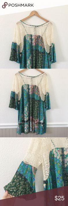 UMGEE Floral and Lace Top with Bell Sleeves This is a brand new Umgee top. It is super flowy, has an unlined lace top with a scoop back with a tie. The sleeves are bell, and it would look great with skinny jeans! Umgee Tops Blouses
