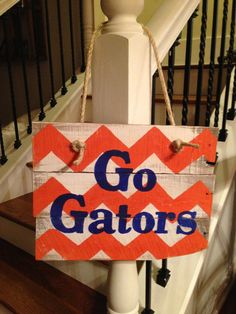 Hey, I found this really awesome Etsy listing at https://www.etsy.com/listing/159866201/go-gators-pallet-wood-sign-door-hanger