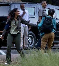 President Barack Obama looks on as Sasha jokes with sister Malia.