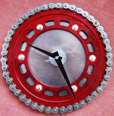 Recycled Clocks from Motorcycles or bicycles. Using the chain, sprocket, a piece of thin aluminum for the back and six short nuts and bolts to tie it all together. Clock works can be bought at the craft stores or a second hand store. I will be making one of these.
