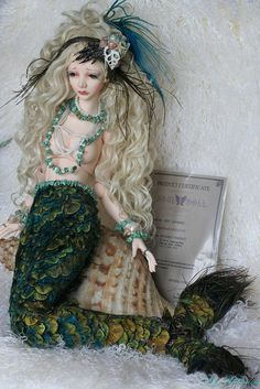 """OOAK LITTLE MERMAID: Souldoll Madalyn by heliantas on Flickr.Via Flickr:  This customisation has won the second price of the contest """"contes et légendes"""" on the ldoll festival 2011.  - Handmade faceup,and body blushing,  - Handmade wig with humain hair,  - Handmade necklaces and  hairband, they are made with real pearls and shells, with 2 legs of real alligator.  - The tail of my mermaid is made with different kind of feathers of peacock, glued one by one, on a sort of corset. This corset"""