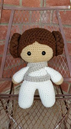 Big Head Baby Doll Cut about 15 to 20 strands of yarn 40 to 50 inches long braid sew them as your making the bun and sew to hat.
