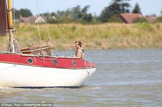 Looking out: Colin - whose reportedly playing amateur sailor Donald Crowhurst in the unnamed film - was spotted on board a small catamaran while shooting scenes, as he was seen looking out into the distance