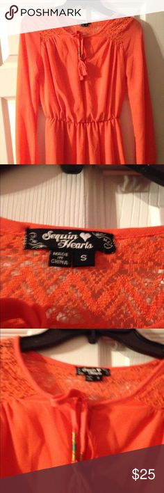 NWOT Sequin Hearts Coral Dress NWOT Sequin Hearts Coral Dress. Chevron Lace print on shoulders and tie. Cute fringe drawstring and perfect for any occasion. Size Small! Sequin Hearts Dresses Midi