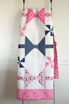 This quilt uses quarter square triangles to make it fast and easy to piece together. Stitch it up in your favorite fabrics! Can easily be customized for a boy or a girl. Pattern includes instructions for both Twin and Baby Sized Quilts!